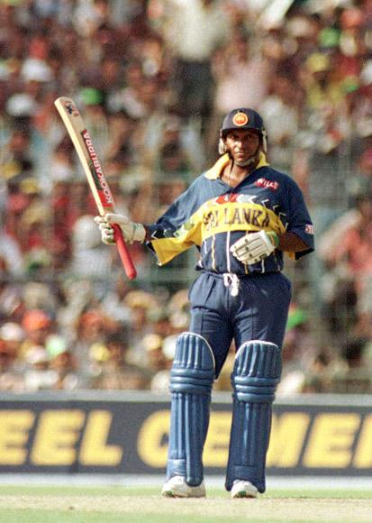 13 Mar 1996: Aravinda De Silva of Sri Lanka salutes the crowd after reaching his half century during the semifinal of the Cricket World Cup between India and Sri Lanka, played at Eden Gardens in Calcutta, India. Mandatory Credit: Ross Kinnaird/Allsport
