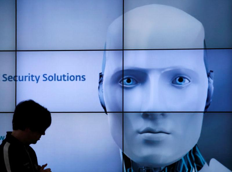 FILE PHOTO: A woman is silhouetted at the ESET booth during preparations at the 2013 CeBit computer fair in Hanover