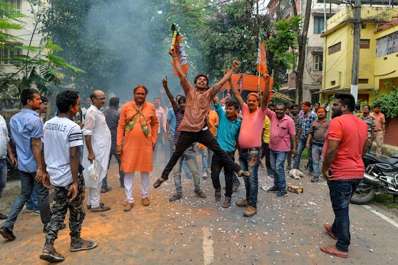 The preliminary count predicts a commanding majority in the lower house for Modi's party and its allies (AFP Photo/DIPTENDU DUTTA)