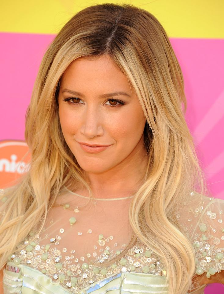 Ashley Tisdale keeps the focus on her sequined-detailed dress with a makeup look that is au naturel. Her lip shade seems to be apricot, a cool shade to wear for summer.