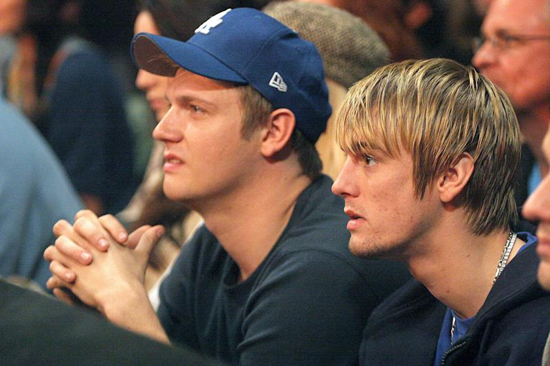 Nick Carter and Aaron Carter during WWE Monday Night RAW with Surprise Guest Kevin Federline at The Staples Center in Los Angeles, California, United States. (Photo by Matthew Simmons/WireImage for World Wrestling Entertainment, Inc)