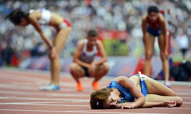 Ukrainian runner Valentyna Horpynych Zhudina (foreground) and fellow competitors are exhausted after the women's 3000m Steeplechase heats at the London 2012 Olympic Games Athletics, Track and Field events at the Olympic Stadium, London, Britain, 04 August 2012. EPA/JOHN MABANGLO