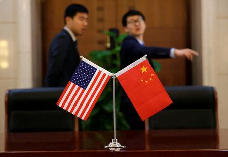 Chinese and U.S. flags are set up for a signing ceremony during a visit by U.S. Secretary of Transportation Elaine Chao at China's Ministry of Transport in Beijing, China April 27, 2018. REUTERS/Jason Lee/Files