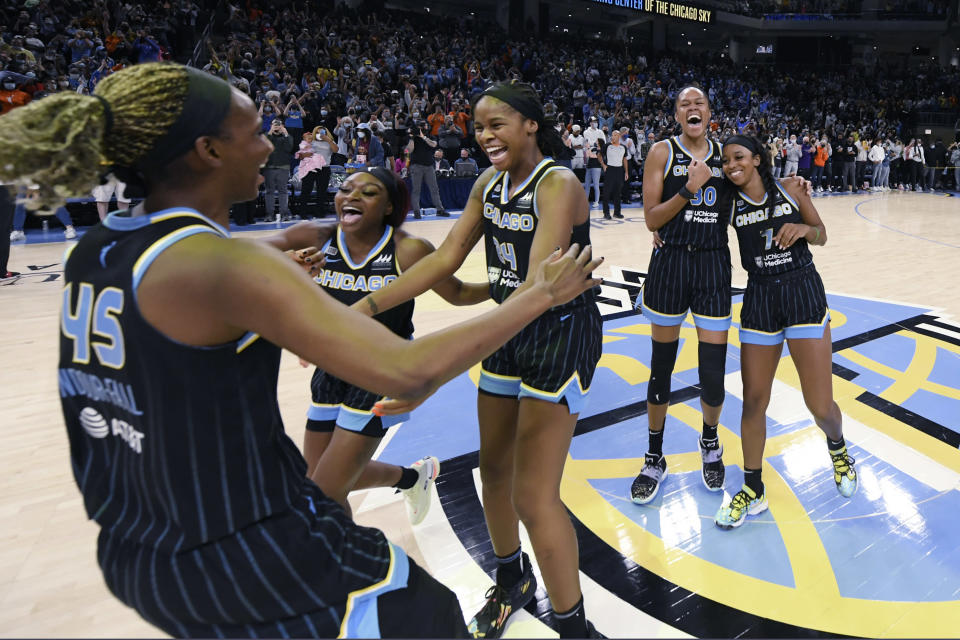 Chicago Sky players celebrate after defeating the Connecticut Sun 79-69 in Game 4 of a WNBA basketball playoff semifinal, Wednesday, Oct. 6, 2021, in Chicago. (AP Photo/Paul Beaty)