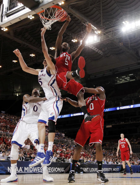 North Carolina State forward C.J. Leslie (5) misses a dunk against Kansas center Jeff Withey (5) during the first half of an NCAA tournament Midwest Regional college basketball game, Friday, March 23, 2012, in St. Louis. (AP Photo/Charlie Riedel)