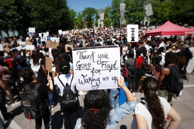 Last June, crowds at Place Émilie-Gamelin in downtown Montreal chanted 'I can't breathe' in French and English — a reference to words uttered by George Floyd, who was killed in police custody in Minneapolis on May 25, 2020.