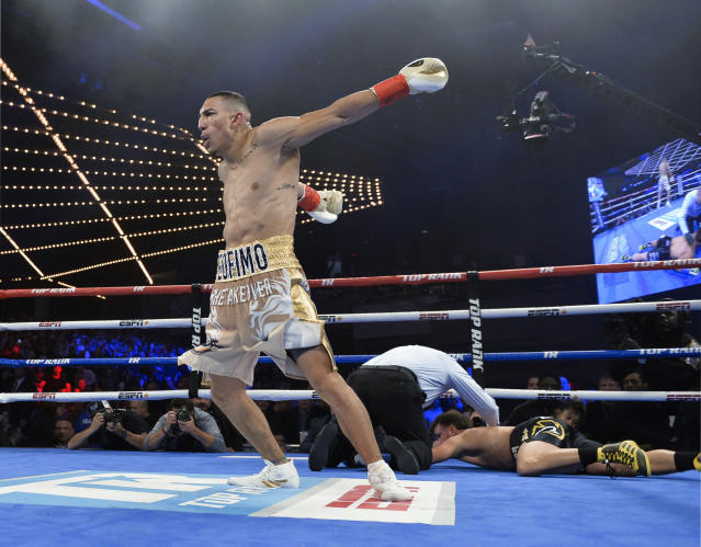 Teofimo Lopez celebrates after knocking out Mason Menard in the first round of lightweight boxing match at Madison Square Garden, Saturday, Dec. 8, 2018, in New York. (AP Photo/Howard Simmons)