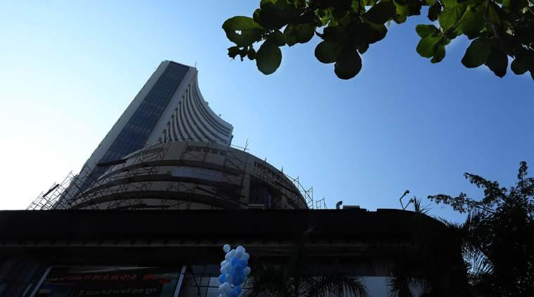 Taking cue from exit polls predicting Modi s return, Sensex surges 1400 points to new high