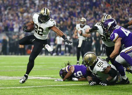 Jan 14, 2018; Minneapolis, MN, USA; New Orleans Saints running back Mark Ingram (22) runs the ball against the Minnesota Vikings in the second quarter of the NFC Divisional Playoff football game at U.S. Bank Stadium. Mandatory Credit: Mark J. Rebilas-USA TODAY Sports - 10543947