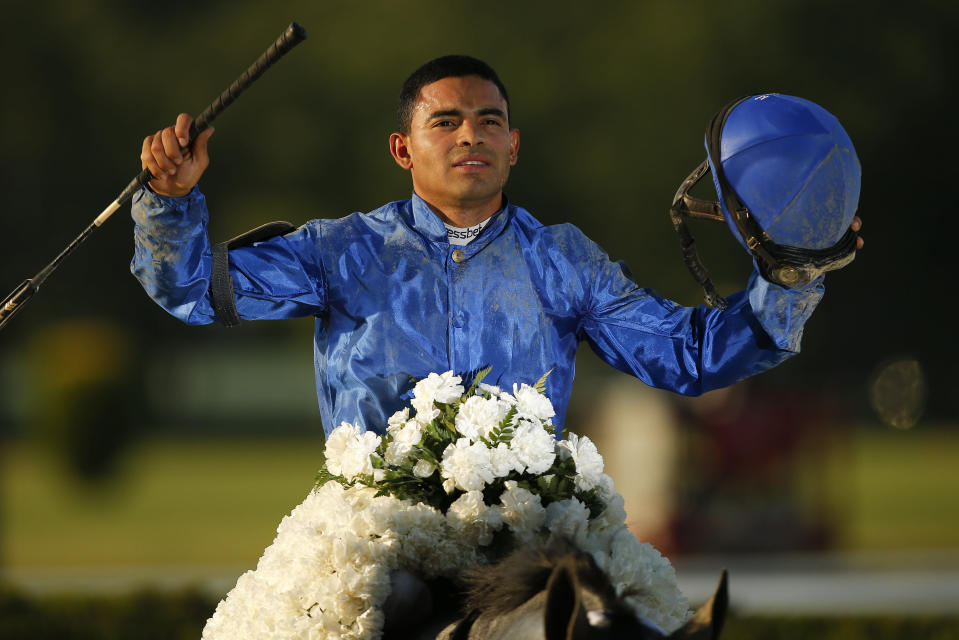 Jockey Luis Saez reacts after winning the 153rd running of the Belmont Stakes horse race with Essential Quality (2), Saturday, June 5, 2021, At Belmont Park in Elmont, N.Y. (AP Photo/Eduardo Munoz Alvarez)