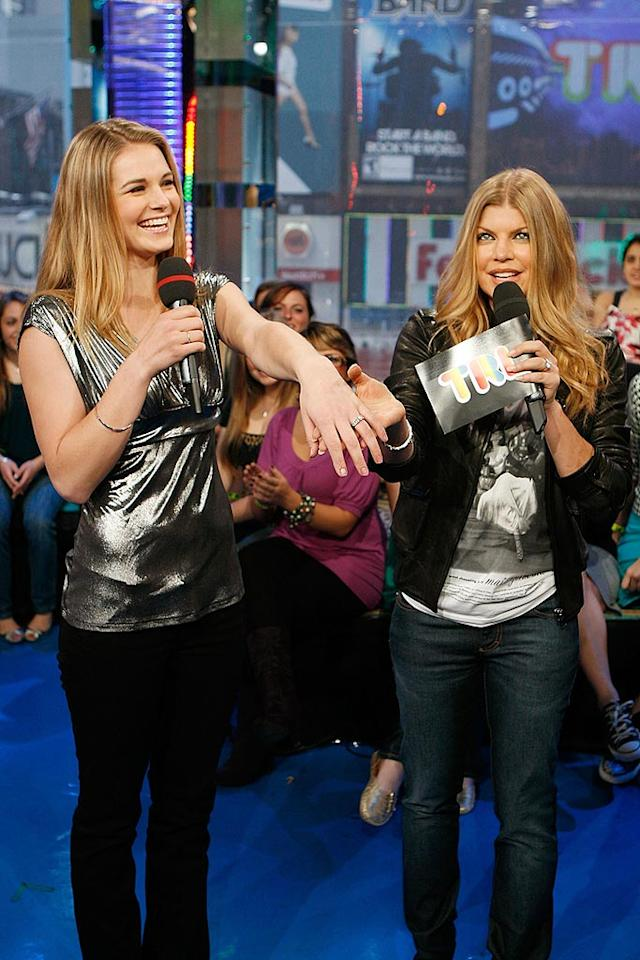 "Fergie chats up ""American Idol"" castoff Kristy Lee Cook, who doesn't mind showing off her shiny new engagement ring. It's probably not nearly as big as Fergie Ferg's! Soul Brother/<a href=""http://filmmagic.com/"" target=""new"">FilmMagic.com</a> - April 21, 2008"