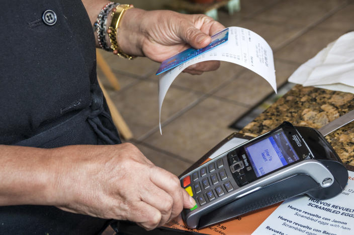 Miami Beach, Tropical Beach Cafe credit card scanner. (Photo by: Jeffrey Greenberg/Universal Images Group via Getty Images)