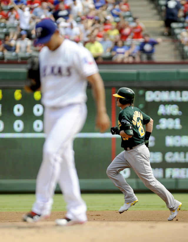 Oakland Athletics' Josh Donaldson (20) rounds the bases after hitting a home run off T exas Rangers starting pitcher Martin Perez, foreground, in the first inning of a baseball game, Sunday, Sept. 15, 2013, in Arlington, Texas. (AP Photo/Matt Strasen)