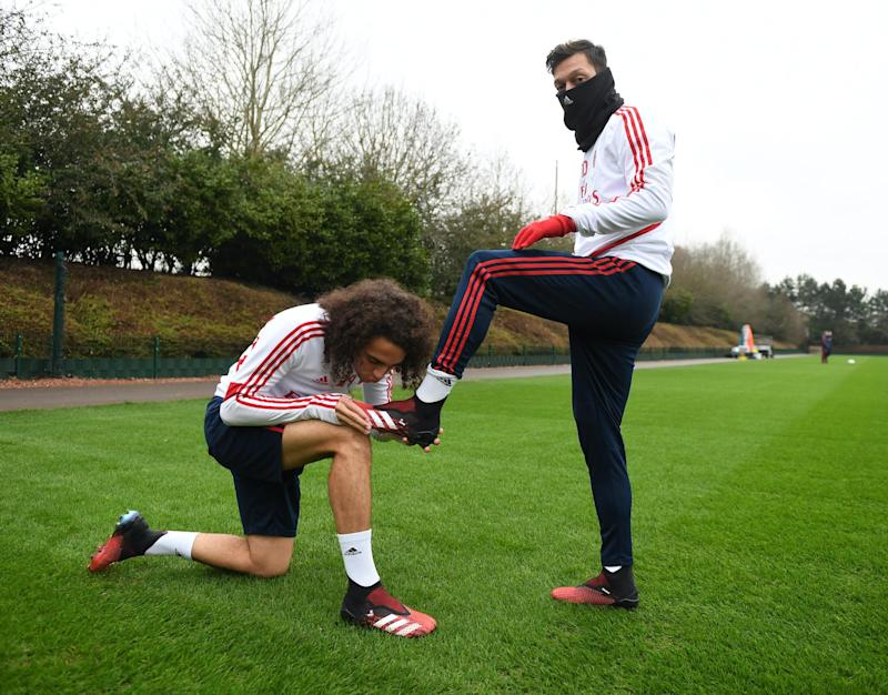 Matteo Guendouzi kisses (R) Mesut Ozil's new adidas predator boot before a training session at London Colney on January 24, 2020 in St Albans, England: Stuart MacFarlane/Arsenal FC via Getty Images