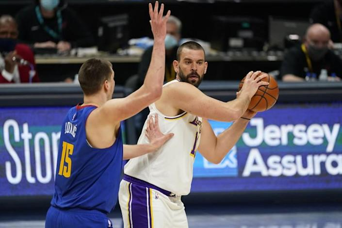 Los Angeles Lakers center Marc Gasol (14) and Denver Nuggets center Nikola Jokic (15) in the second half of an NBA basketball game Sunday, Feb. 14, 2021, in Denver. (AP Photo/David Zalubowski)