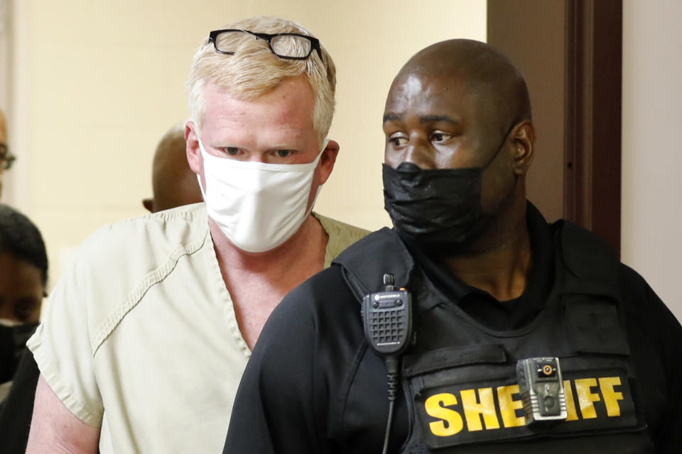 Alex Murdaugh walks into his bond hearing Thursday, Sept. 16, 2021, in Varnville, S.C. Murdaugh surrendered Thursday to face insurance fraud and other charges after state police said he arranged to have himself shot in the head so that his son would get a $10 million life insurance payout. (AP Photo/Mic Smith)