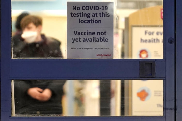 FILE - In this Jan. 16, 2021, file photo, a sign saying that a COVID-19 vaccine is not yet available hangs at Walgreens in Glenview, Ill. Smaller-than-expected vaccine deliveries from the federal government have caused frustration and confusion and limited states' ability to attack the outbreak that has killed over 400,000 Americans.(AP Photo/Nam Y. Huh, File)