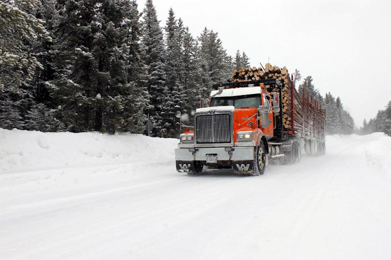 A logging truck races through forest north of the Indian Cree community of Waswanipi, 373 miles north of Montreal, Canada on March 11, 2014