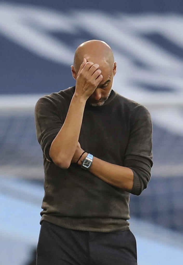 Manchester City's head coach Pep Guardiola reacts after Leicester scored their 4th goal of the game during the English Premier League soccer match between Manchester City and Leicester City at the Etihad stadium in Manchester, England, Sunday, Sept. 27, 2020. (Catherine Ivill/Pool via AP)