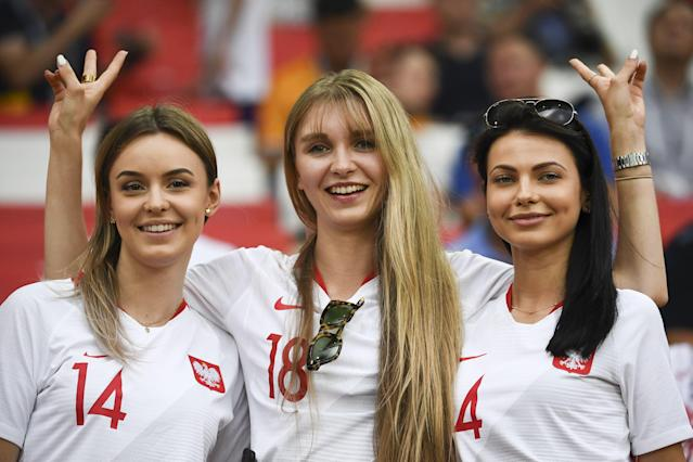 <p>Poland's fans cheer prior to the Russia 2018 World Cup Group H football match between Poland and Senegal at the Spartak Stadium in Moscow on June 19, 2018. (Photo by FRANCK FIFE / AFP) </p>
