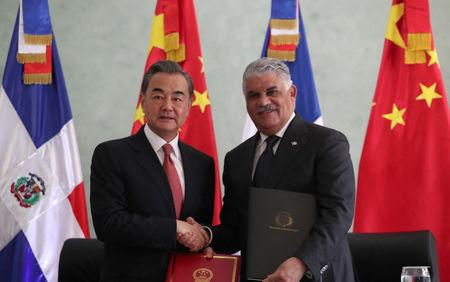 China's Foreign Minister Wang Yi and Dominican Republic's Chancellor Miguel Vargas shake hands after signing a bilateral agreement in Santo Domingo, Dominican Republic September 21, 2018. REUTERS/Ricardo Rojas