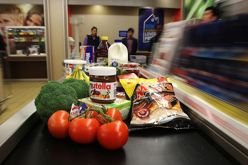 Products sit on a conveyor at the check-out counter of an Aldi Stores Ltd. food store in Sydney. Source: Getty