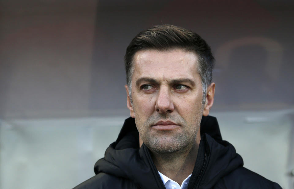 In this Saturday Nov. 17, 2018, Serbia coach Mladen Krstajic looks out from the bench prior the UEFA Nations League soccer match between Serbia and Montenegro at Rajko Mitic stadium in Belgrade, Serbia. Serbia's soccer association has fired national team coach Mladen Krstajic after a humiliating loss against Ukraine in a European Championship qualifier. Krstajic, a former national team defender and Bundesliga veteran, was named the national team coach ahead of the World Cup in Russia last year despite having never held a previous coaching position. (AP Photo/Darko Vojinovic, File)