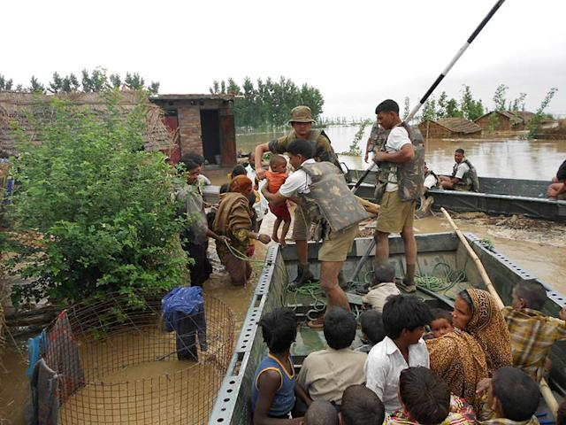 "In this photograph received from the Defence Ministry on June 19, 2013 members of the Indian Defence Forces rescue stranded villagers in the northern Uttarakhand state. Military helicopters dropped emergency supplies June 19 to thousands of people stranded by flash floods that tore through towns and temples in northern India and neighbouring Nepal, killing more than 160, officials said. AFP PHOTO/DEFENCE MINISTRY ----EDITORS NOTE---- RESTRICTED TO EDITORIAL USE - MANDATORY CREDIT - ""AFP PHOTO / DEFENCE MINISTRY"" - NO MARKETING NO ADVERTISING CAMPAIGNS - DISTRIBUTED AS A SERVICE TO CLIENTS -----"