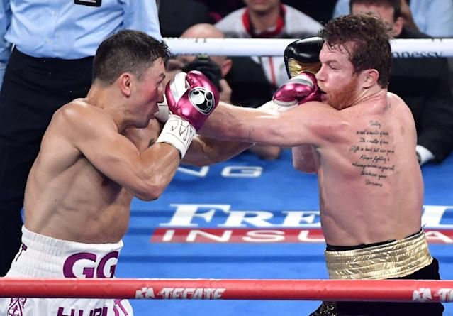 Gennadiy Golovkin (L) and Canelo Alvarez battle in the second round of their WBC/WBA middleweight title fight at T-Mobile Arena on Sept. 15, 2018, in Las Vegas. (Ethan Miller/Getty Images)