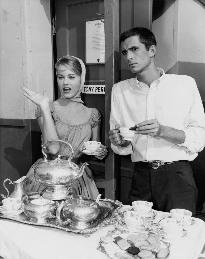 <p>Jane Fonda chats with her <em>Tall Story </em>costar, Anthony Perkins, while the two take a coffee break on the Warner Bros. set. </p>