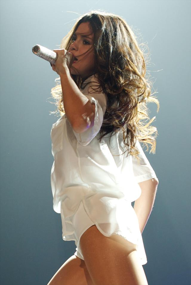 MADRID, SPAIN - SEPTEMBER 12: Selena Gomez performs on stage at the Vistalagre Palace on September 12, 2013 in Madrid, Spain. (Photo by Carlos Alvarez/Redferns via Getty Images)