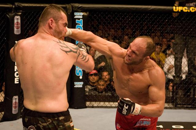 Randy Couture lands a right to the chin of Tim Sylvia en route to winning the heavyweight title at UFC 68 in 2007. (Getty Images)