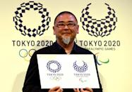 Designer Asao Tokolo holds the new Tokyo Olympics logo after the original had to be ditched following a plagiarism scandal