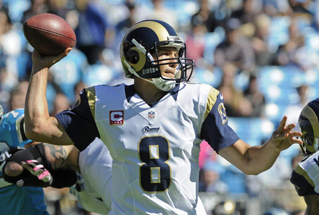 St. Louis Rams quarterback Sam Bradford (8) looks to pass against the Carolina Panthers in the first half of an NFL football game in Charlotte, N.C., Sunday, Oct. 20, 2013. (AP Photo/Mike McCarn)