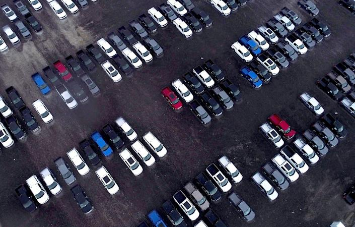 Hundreds of new Ford F-150 pickup trucks sit on a lot of the Department of Public Works rail yard off I-96 near Evergreen in Detroit on April 15, 2021. The trucks are waiting for semiconductors, which have been in limited supply globally because of COVID disruption.