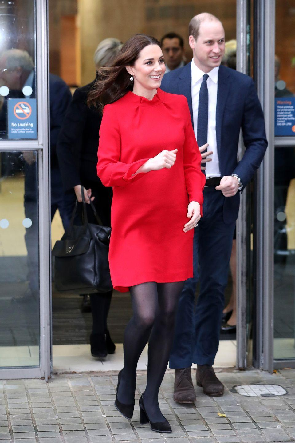 <p>The Duchess wears a red long-sleeved dress by Goat Fashion, black tights, and black pumps with Prince William at the Manchester Central Convention Complex.</p>