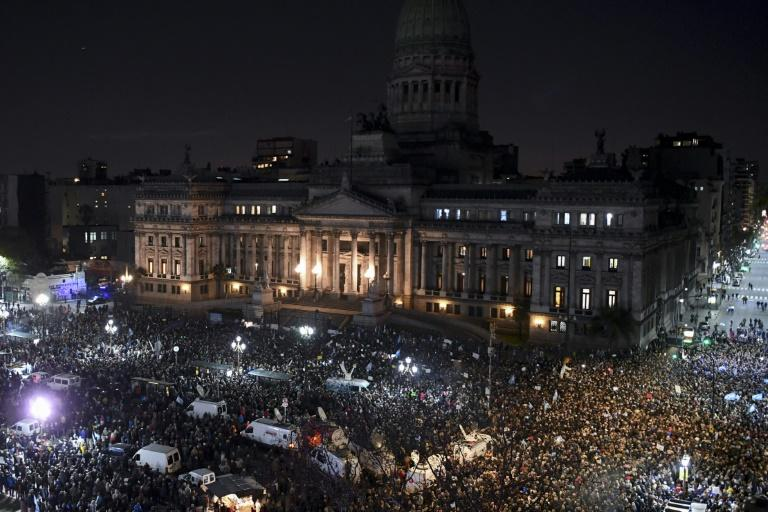 Thousands demonstrate outside the Congress in Buenos Aires to demand the Senate approve the lifting of former president Cristina Kirchner's immunity as part of a anti-corruption investigation, on August 21, 2018
