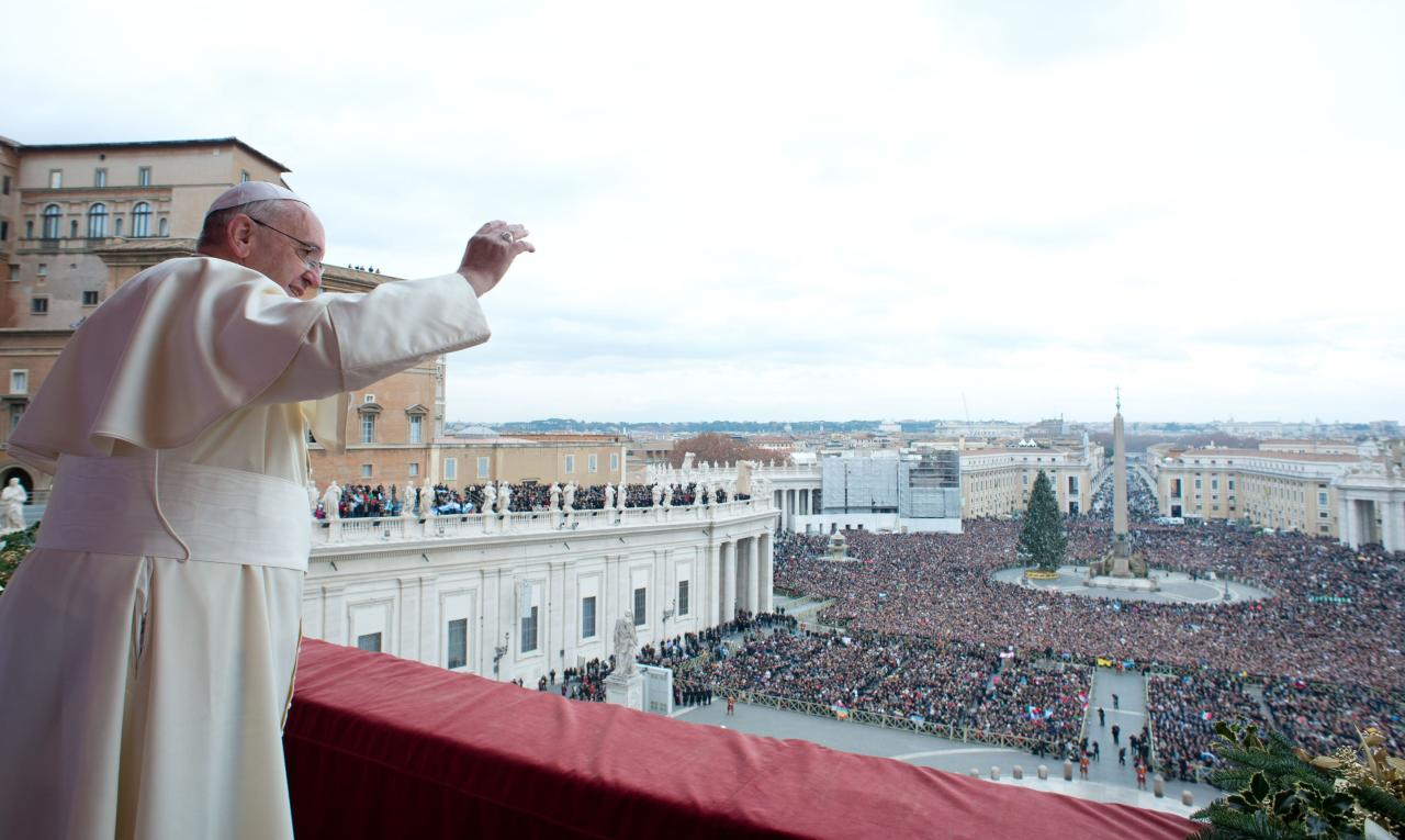 "Pope Francis waves as he delivers his first ""Urbi et Orbi"" (to the city and world) message from the balcony overlooking St. Peter's Square at the Vatican December 25, 2013. Francis, celebrating his first Christmas as Roman Catholic leader, on Wednesday called for dialogue to end the conflict in South Sudan and all wars, saying everyone should strive to be personal peacemakers. 