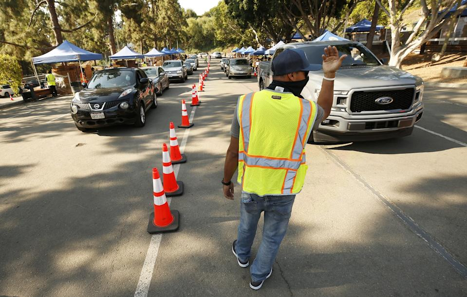 Christopher Escoto, who works for the L.A. County Department of Public Works, directs traffic at the Hollywood Bowl.
