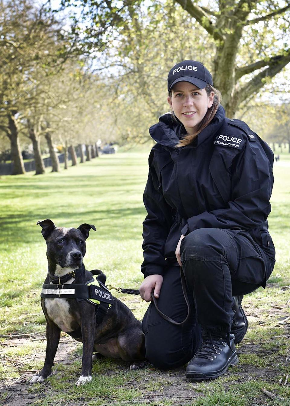 Undated handout photo issued by Thames Valley Police of police dog handler PC Camilla Carter and five-year-old Roxy, an unwanted Staffie which was rescued by RSPCA officers after being abandoned in 2017 and which has now become the only Staffie working as an explosives search dog in the UK helping to protect the royal family and the only type of her breed working in the Hampshire and Thames Valley police dog unit. Issue date: Tuesday June 1, 2021.