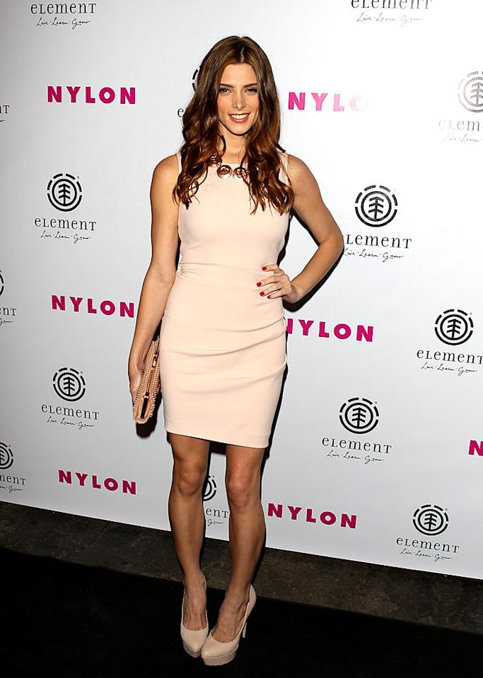 "Meanwhile -- at the <em>NYLON</em> August issue launch party -- ""Twilight's"" Ashley Greene rocked a pale pink Emilio Pucci shift dress and a gold statement necklace. The cover girl also took the opportunity to debut her newly lightened locks on Tuesday night. What do you make of Ms. Greene's tawny-tinted mane? Hot or not? (7/31/2012)<br><br><a target=""_blank"" href=""http://movies.yahoo.com/movie/the-twilight-saga-breaking-dawn-part-2/"">Watch the ""Breaking Dawn - Part 2"" trailer here!</a>"