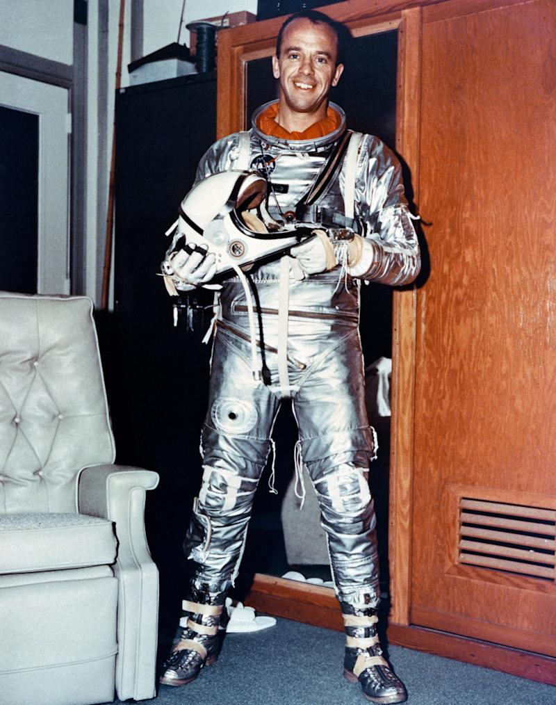 In this May 5, 1961 image released by  NASA, U.S. astronaut Alan B. Shepard  Jr., is seen in his space suit prior to  launch on the spacecraft Freedom 7 at the Kennedy Space Center at Cape Canaveral, Fla. Shepard became the first astronaut to man a spacecraft in orbit . NASA is celebrating the 50th anniversary of the U.S. human flight with several ceremonies and a parade. The U.S. Postal service will unveil two new stamps, one commemorates NASA's Project Mercury and Shepard's history launch and the other honor's NASA's Messenger, which became the first spacecraft to orbit the planet Mercury. (AP Photo/NASA, HO)