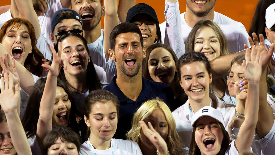 Novak Djokovic (pictured middle) posting for a photo with the Adria Tour tournament volunteers in 2020.
