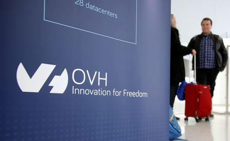 Visitors stand at the French web-hosting and server provider OVH Group new headquarters in Paris,