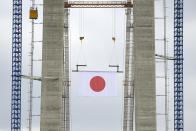 The flag of Japan hangs from the structure during a ceremony marking 100 years of diplomatic relations between Japan and Romania, at the construction site of a suspension bridge over the Danube river in Braila, Romania, Thursday, Aug. 26, 2021. The bridge, built by Japanese and Italian companies, with a span of 1,974.3 meters, will be the largest of its kind in Romania and the third in the European union.(AP Photo/Vadim Ghirda)