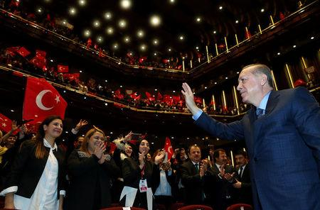 Turkey's President Erdogan greets the audience during a meeting in Ankara