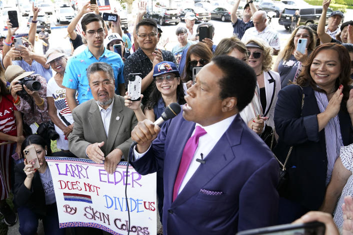 """FILE - In this July 13, 2021, file photo, conservative radio talk show host Larry Elder speaks to supporters during a campaign stop in Norwalk, Calif. Elder has filed a lawsuit Monday, July 19, 2021, challenging a decision by California election officials to block him from running in the state's Sept. 14 recall election, saying he's the target of political """"shenanigans"""" by Sacramento Democrats. (AP Photo/Marcio Jose Sanchez, File)"""