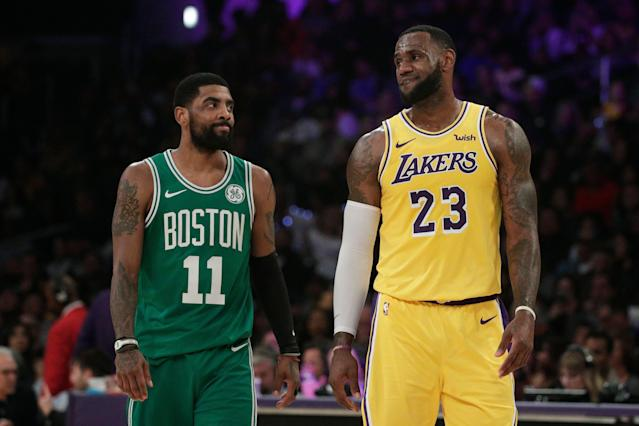 Kyrie Irving (left) could reunite with LeBron James (right) on the Lakers. (AP Photo/Jae C. Hong)