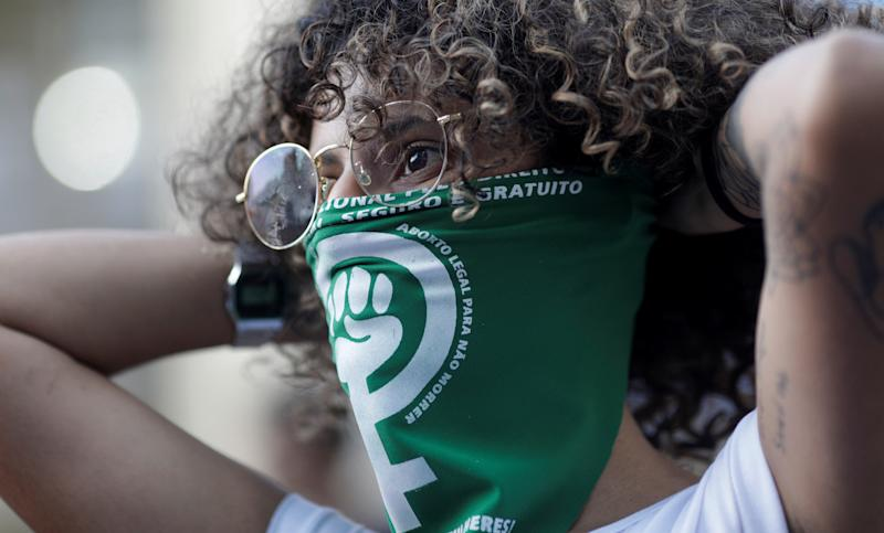 Abortion rights activists attend a demonstration for legalizing abortion in Latin America in Rio de Janeiro, Brazil August 8, 2018. REUTERS/Ricardo Moraes