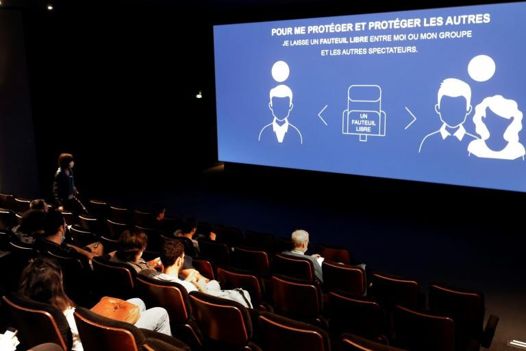 A Paris cinema reminds film lovers of its social distancing rules